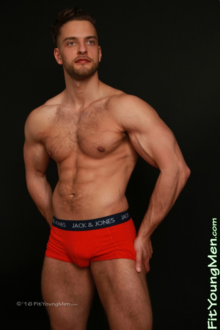 Sexy 22 year old personal trainer Joey Wills shows off his huge cock bulge
