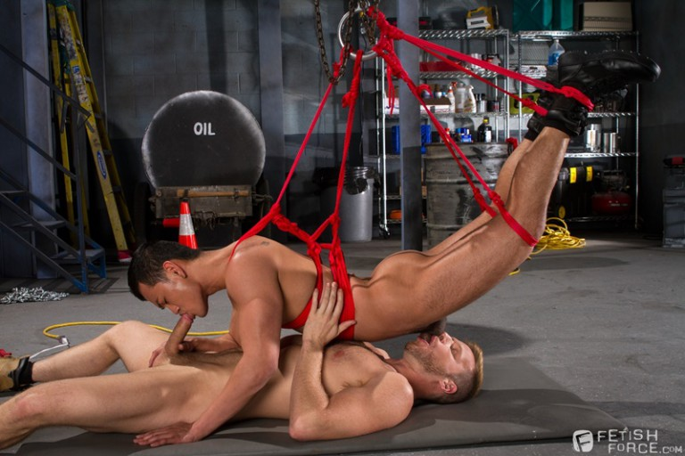 Eli Lewis jerks his cock as Brian Bonds thrusts deep inside his sub's tight hole